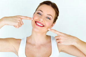 a woman smiling after getting cosmetic dentistry northside tx