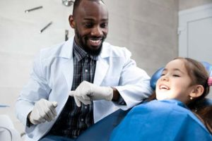 child learning about Dental Bonding
