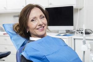 Woman prepares for restorative dentistry services