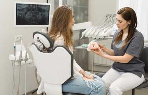 dentist and patient discussing orthodontics